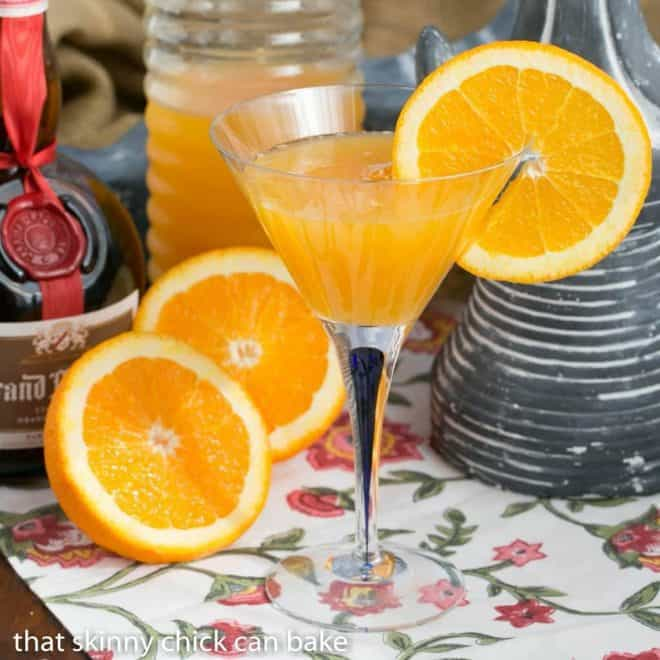 Grand Marnier Mimosa in a martini glass garnished with a slice of orange on the rim