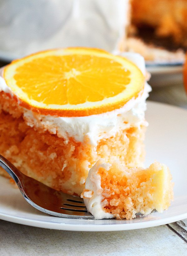 slice of Skinny Orange Dreamsicle Cake on a white plate