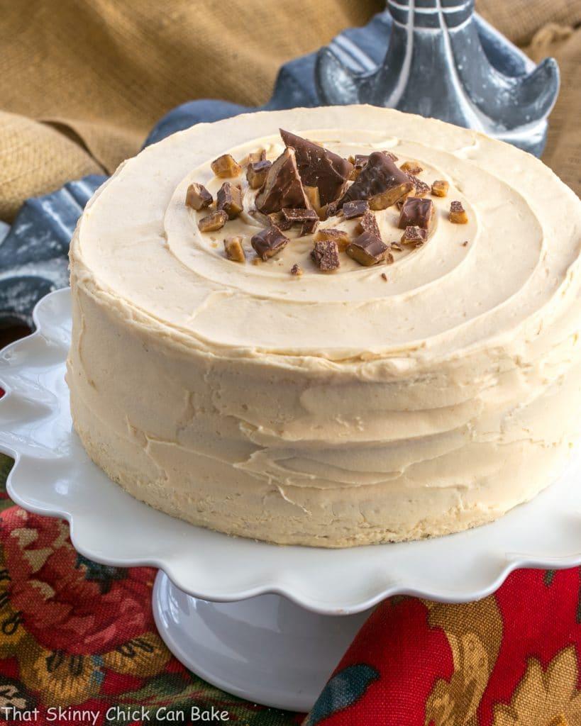 3 Layer Caramel Cake on white pedestal.