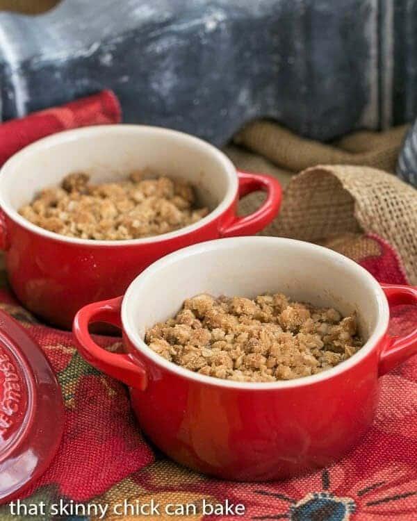 2 bowls of Apple Pear Crisp in small red crocks