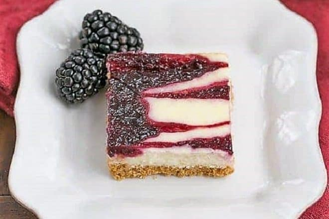 Blackberry Cheesecake Bar on a square white plate