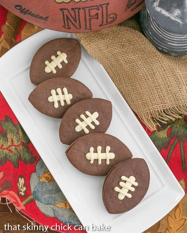 Chocolate Football Cookies on a white, rectangular platter