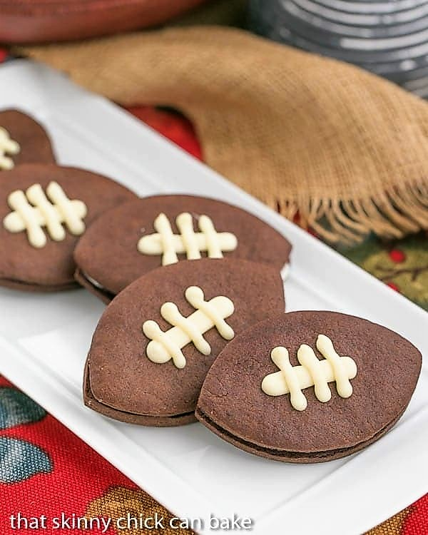 White platter with a number of Chocolate Football Cookies