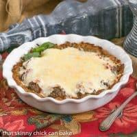 Italian Poutine Pie | A savory pie with a hash brown crust, marinara, meatballs and gooey mozzarella