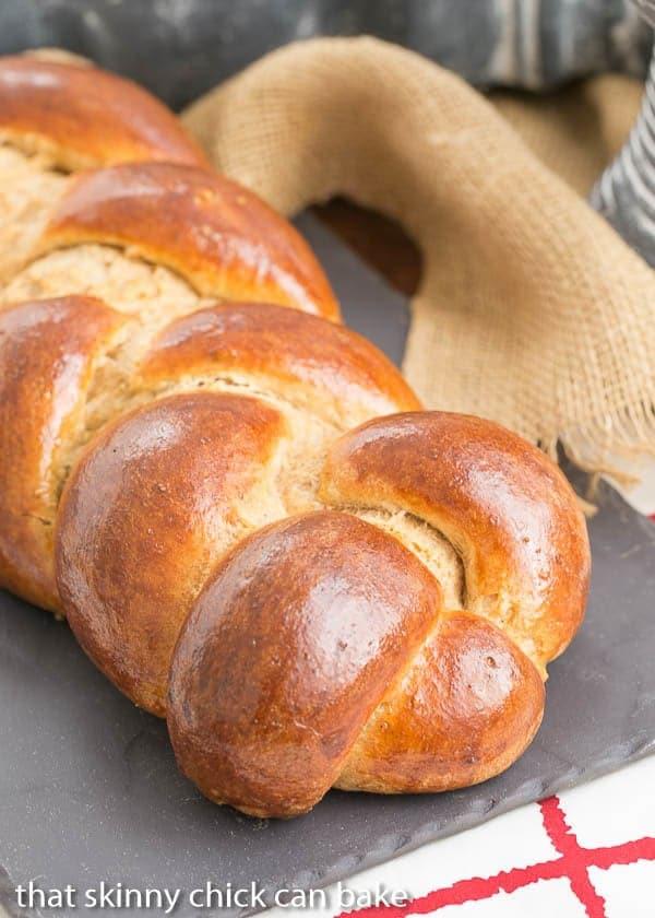 Whole Wheat Challah loaf on a slate tray