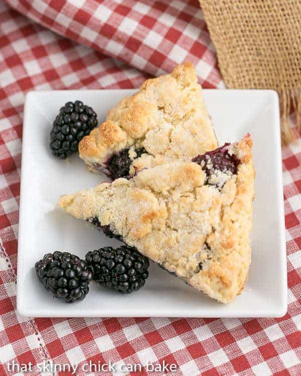 Overhead view of 2 of the best scones recipe with blackberries on a white plate