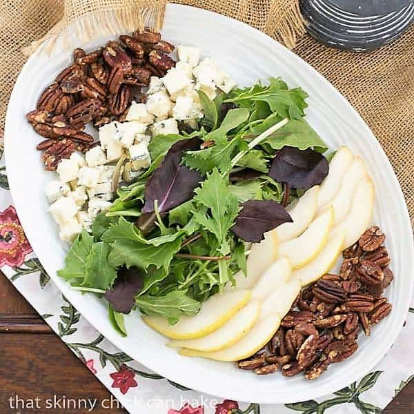Blue Cheese and Pear Salad on a white, oval ceramic plate