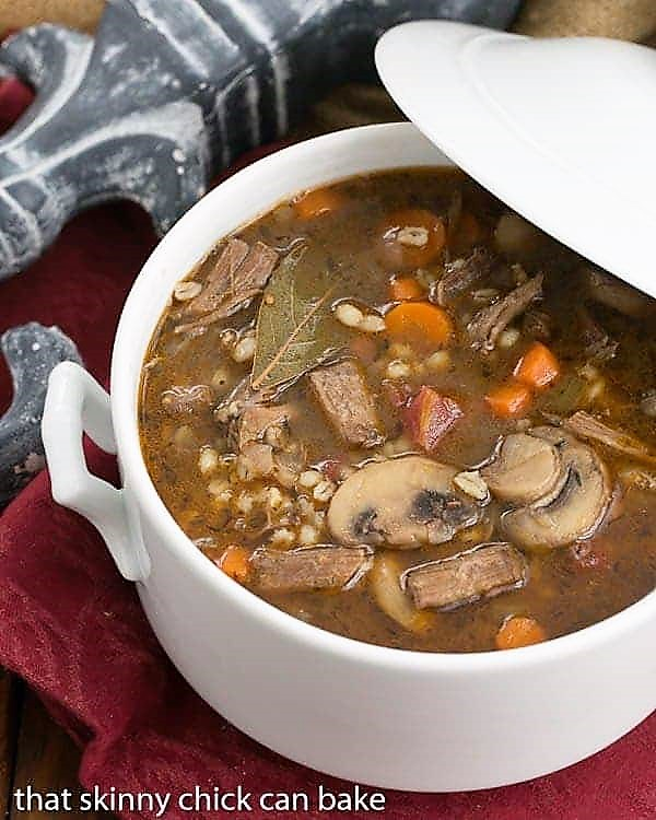 Homemade Beef Barley Soup in a white soup terrine