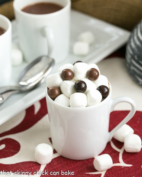Luscious, thick Italian Hot Chocolate in a white ceramic mug with mini marshmallows and chocolate candies