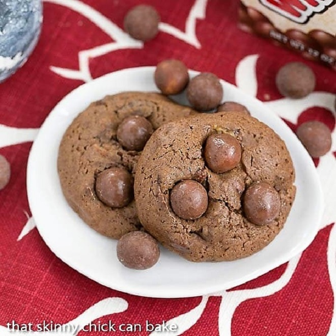 Overhead view of Chocolate malt cookies on an oval white plate