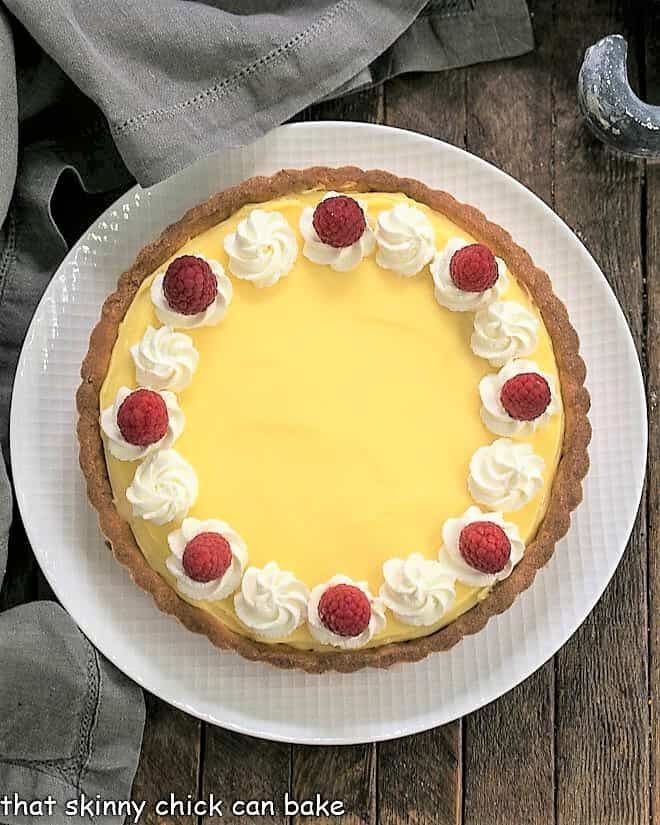 Overhead view of Creamy Lemon Tart on a white plate