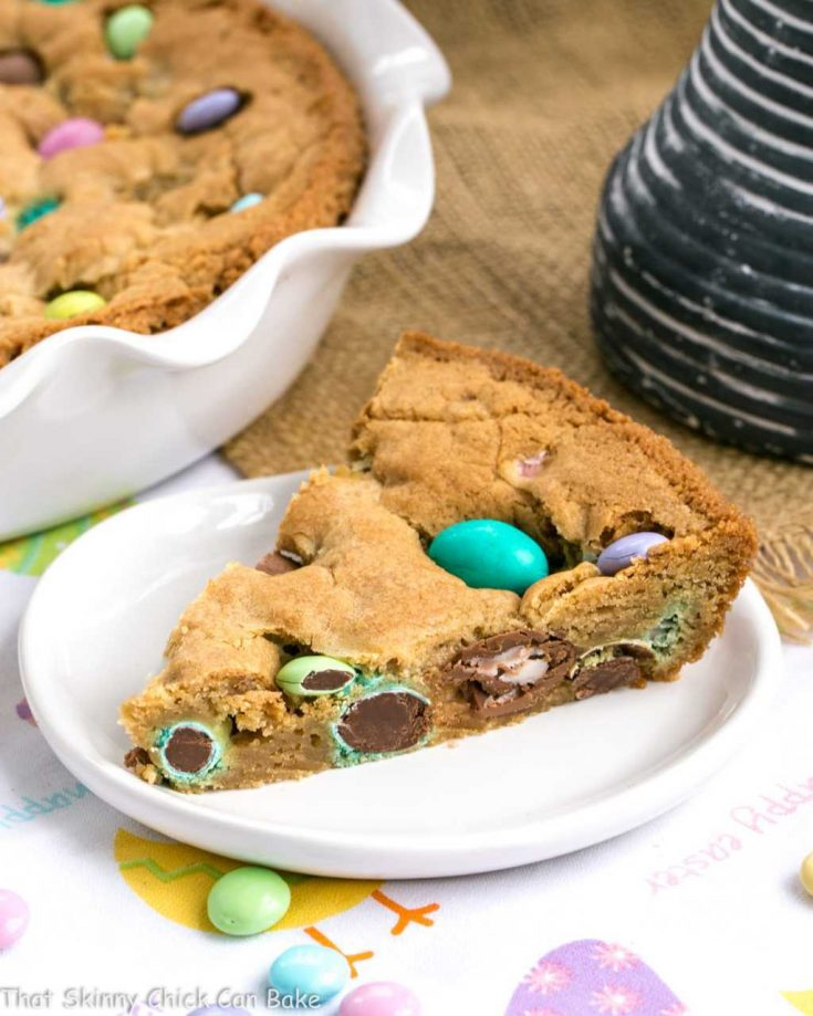 a slice of Easter Cookie Cake on a white dessert plate