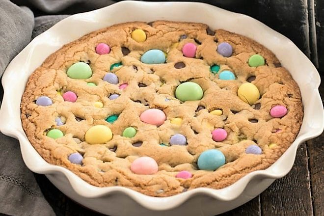 Easter candy cookie cake in a white ceramic pie plate