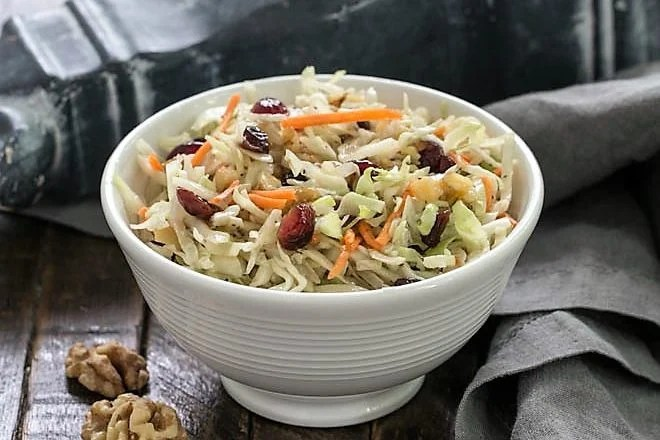Bowl of easy coleslaw in a small white ceramic bowl