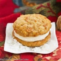 Carrot Cake Whoopie Pie sitting on a bed of flaked coconut