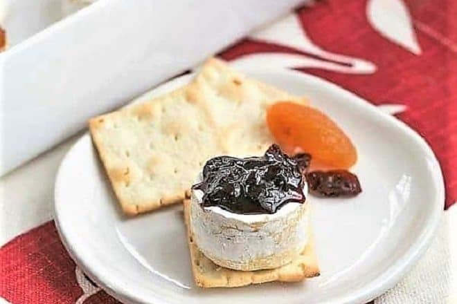 Cherry Topped Brie Bites on a small appetizer plate