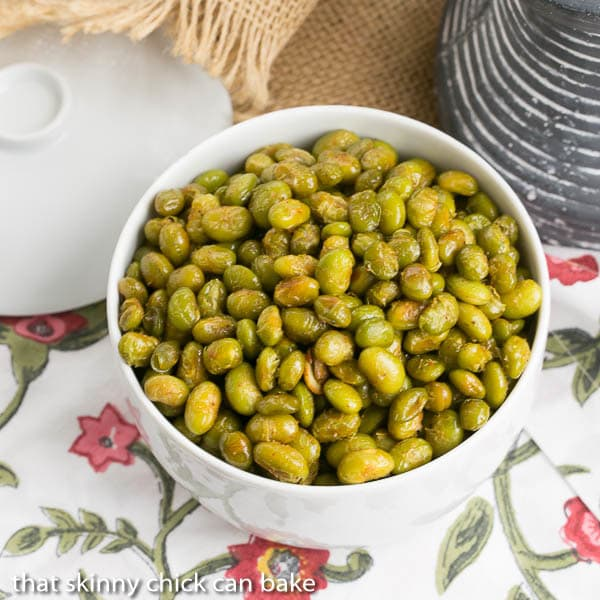 Roasted Creole Edamame in a white bowl viewed from above