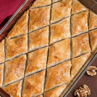 Overhead view of Classic Greek Baklava cut into diamond shapes in a glass 9x13-inch pan