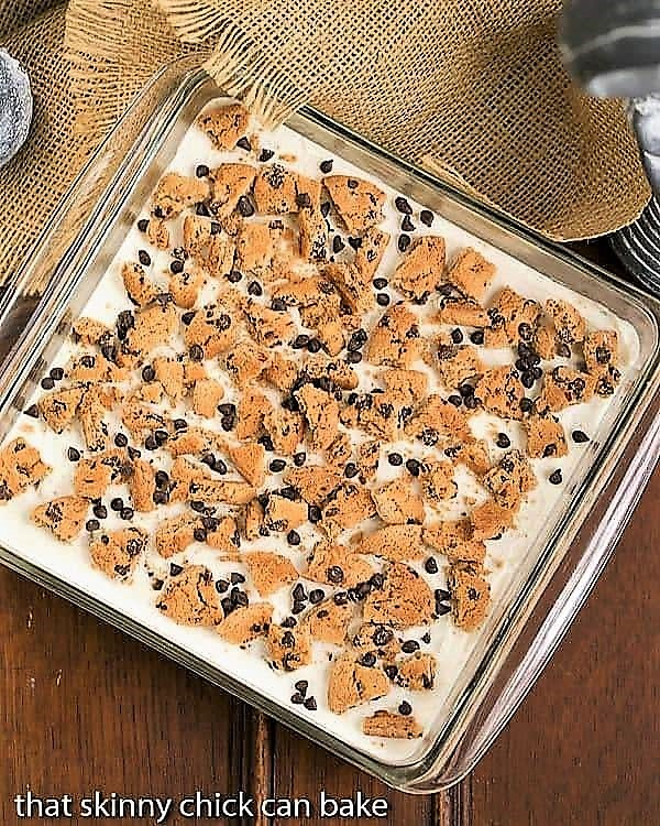 Overhead view of Milk & Cookies Lasagna in a square, glass pan