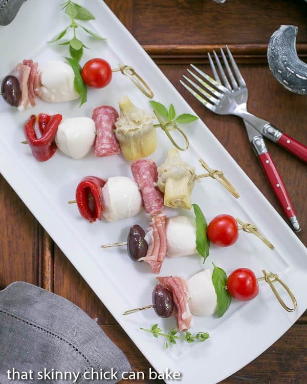 Antipasto Skewers on a rectangular white tray