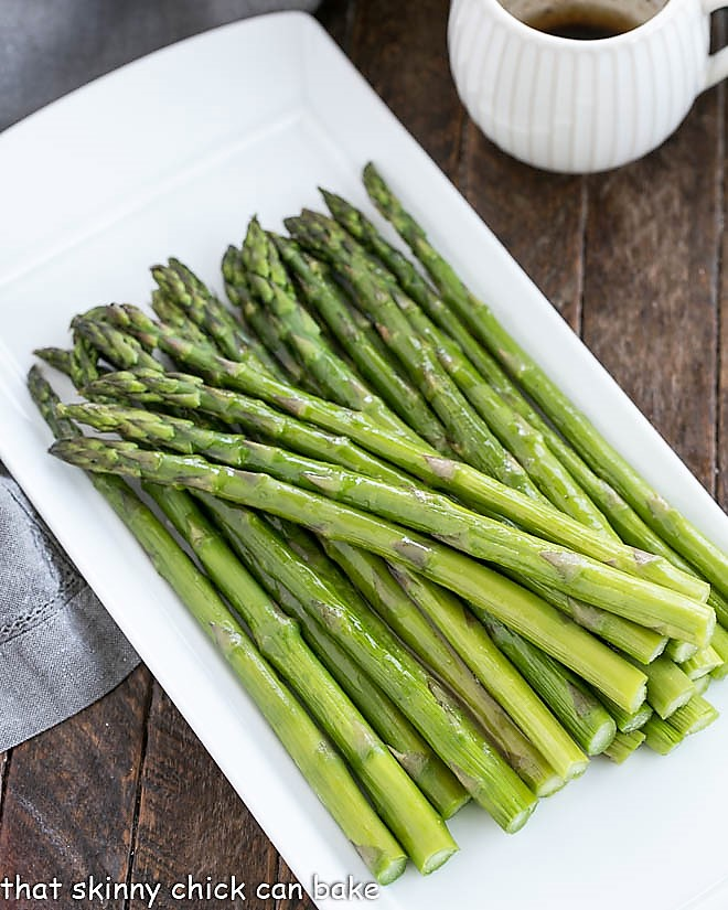Roasted Asparagus with Balsamic Brown Butter on a white platter