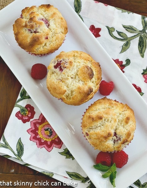 Overhead view of Raspberry White Chocolate Muffins on a white tray