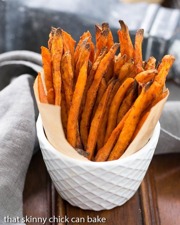 Spicy Sweet Potato Fries standing upright in a white ceramic bowl