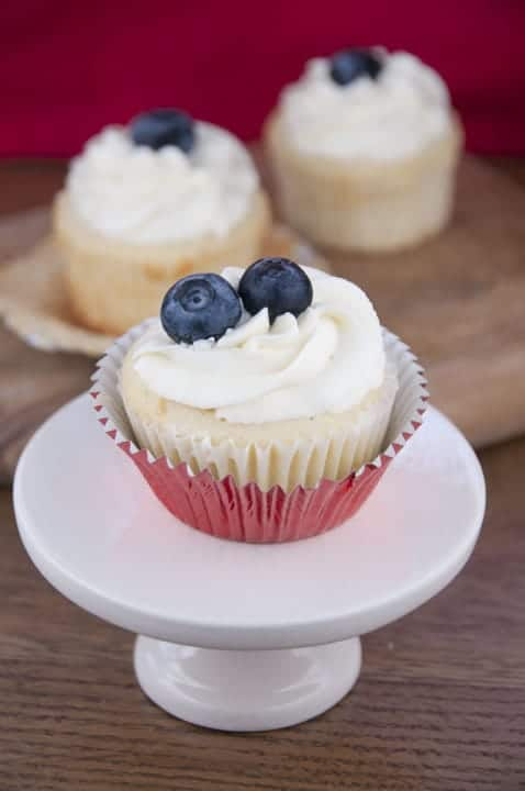 Strawberry Filled Patriotic Cupcakes on a mini white cake stand