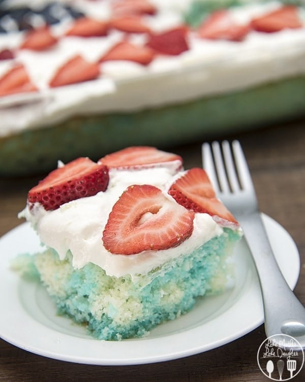 Red White and Blue Jello Poke Cake on a white plate with a silver fork
