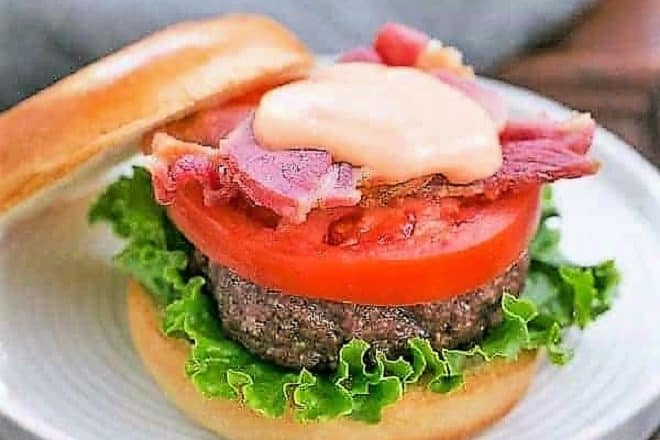 BLT Burge with Spicy Mayonnaise on a round white plate
