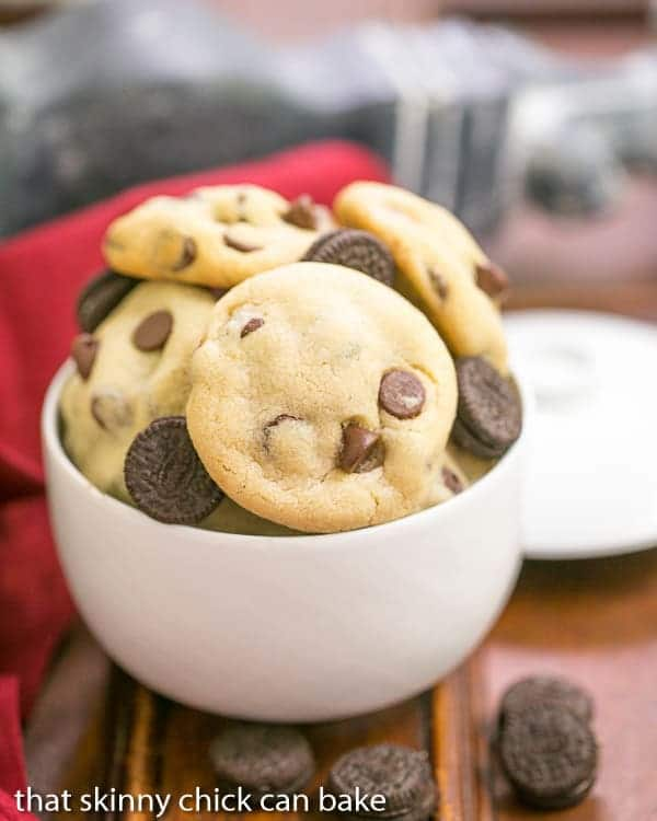 Oreo Stuffed Chocolate Chip Cookies piled in a white bowl