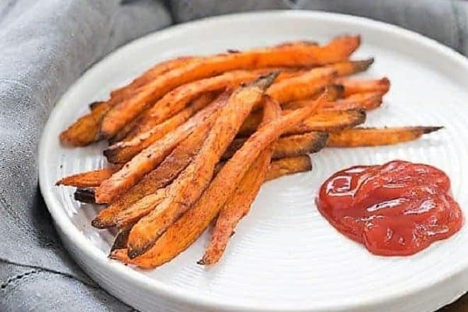 Spicy Sweet Potato Fries served on a white plate with ketchup