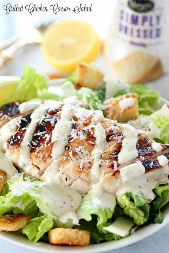 Grilled chicken caesar salad in a white bowl