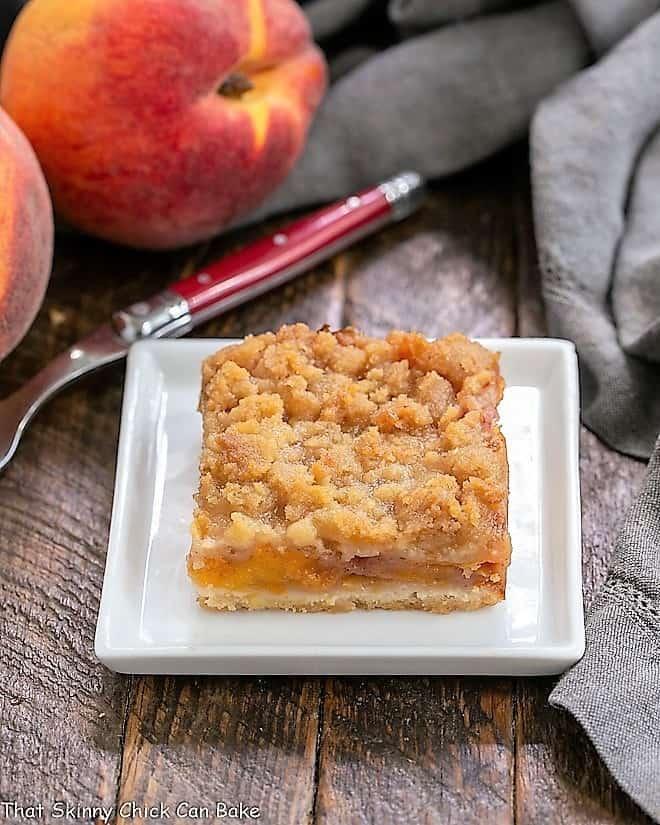 A fresh peach bar on a square white plate