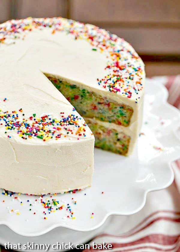 Festive Confetti Layer Cake with a wedge removed