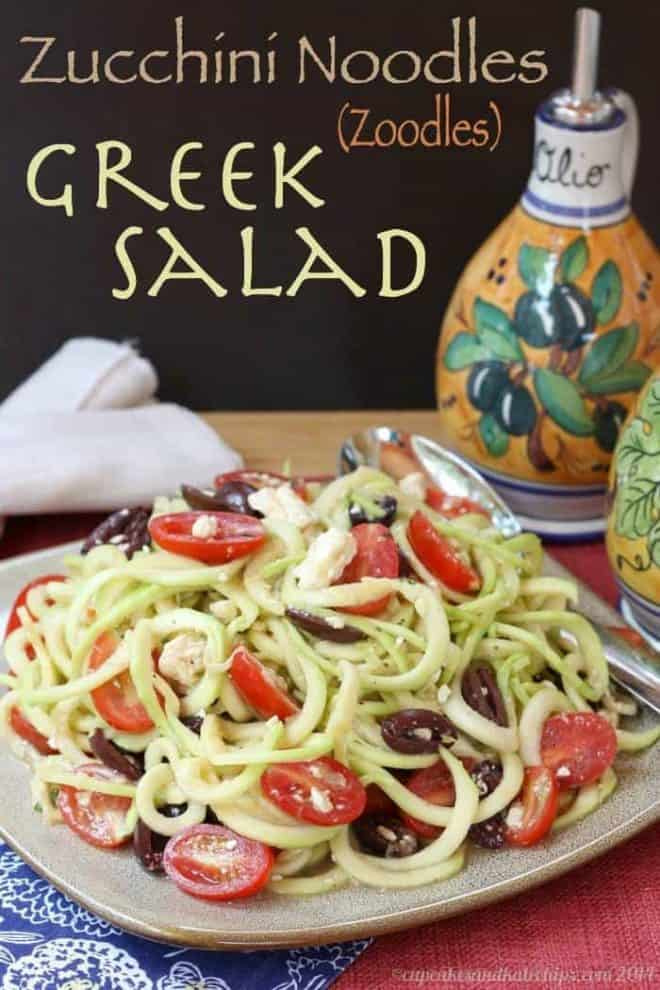 A Greek salad with zucchini noodles on a plate