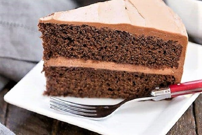 Mocha Layer Cake slice on a square white plate