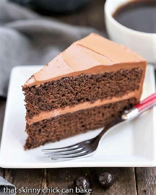 Mocha Layer Cake slice on a white plate