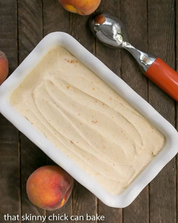No Churn Roasted Peach Ice Cream in a white ceramic loaf pan