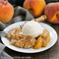 Peach pudding on a white plate with a scoop of vanilla ice cream