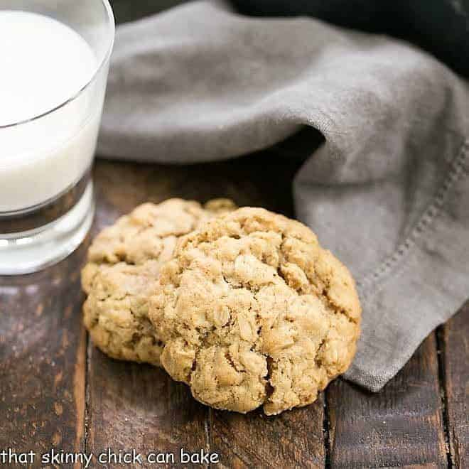 Two Chewy Oatmeal Cookies with a glass of milk