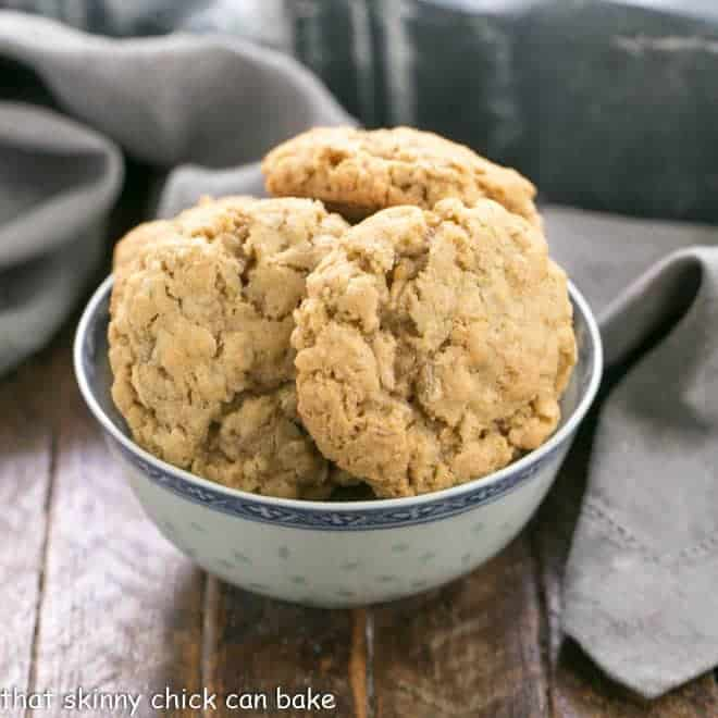 Chewy oatmeal cookies in a blue and white bowl with a gray napkin