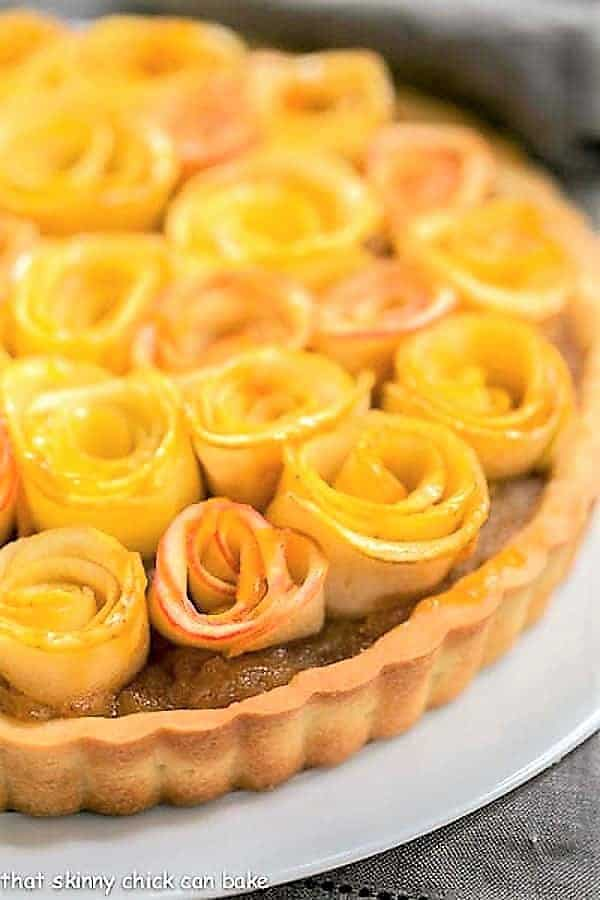 Close up view of Rose Apple Tart on a white cake plate