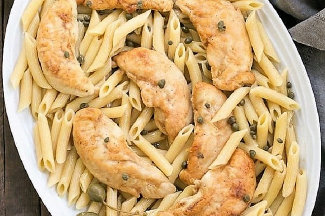 Overhead view of Chicken Piccata Pasta on a oval platter