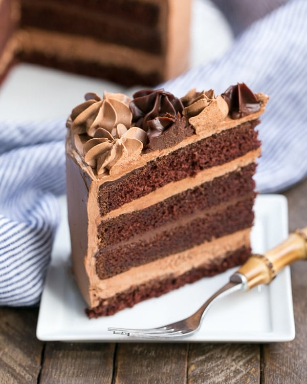 Chocolate Fudge Layer Cake slice on a square white plate