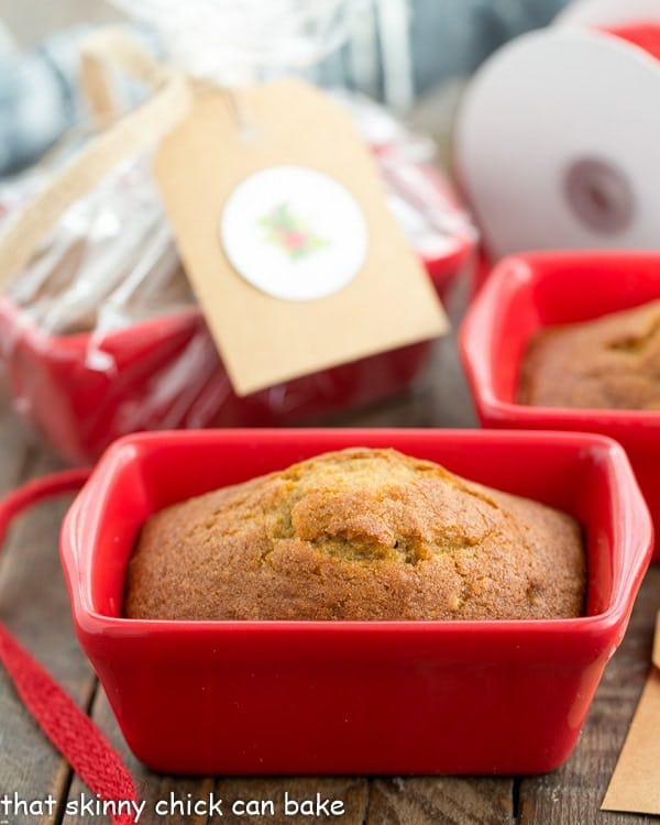 Mini Pumpkin Breads in a small red ceramic loaf pan