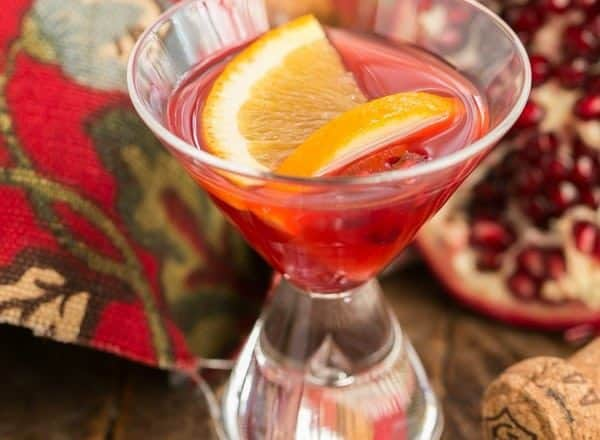 Pomegranate Champagne Cocktail | Pomegranate juice, Grand Marnier and Champagne dance together in this fabulous sparkling cocktail!