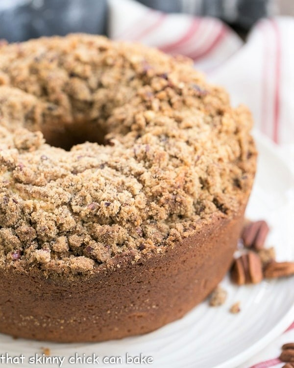 Streusel Coffeecake Pound Cake on a white plate with a view of the top covered with crumbs