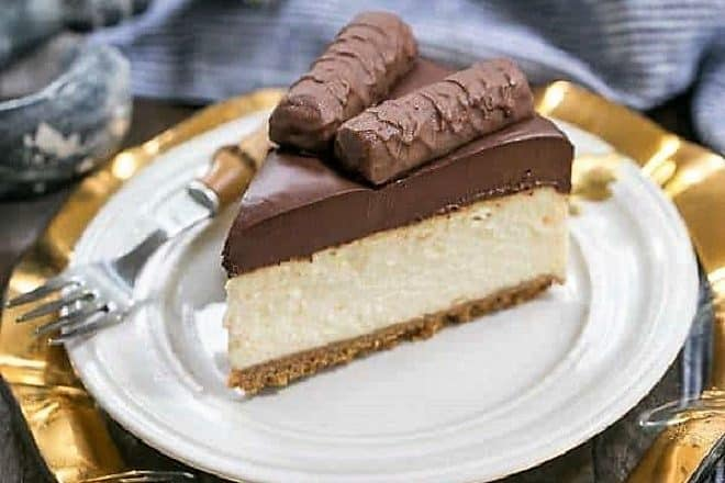 Twix cheesecake slice on a white plate