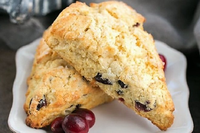 Cranberry eggnog scones on a square white plate